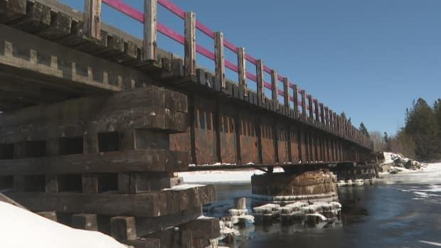 This walking, biking and snowmobiling bridge over the Morell River is the longest one on the Confederation Trail network.  (Brian Higgins/CBC - image credit)