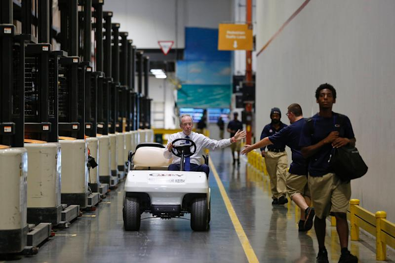 Keith Koenig, then-CEO of City Furniture (and now president), rides through his wear house giving high fives to the employees in Tamarac, Fla. on June 26, 2018. (Photo: AP:/Brynn Anderson)