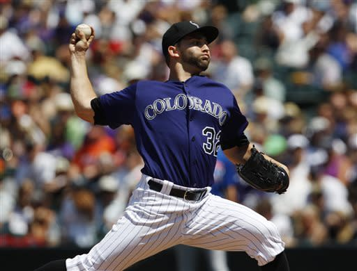 Colorado Rockies starting pitcher Tyler Chatwood works against the Chicago Cubs in the first inning of a baseball game in Denver, Sunday, July 21, 2013. (AP Photo/David Zalubowski)