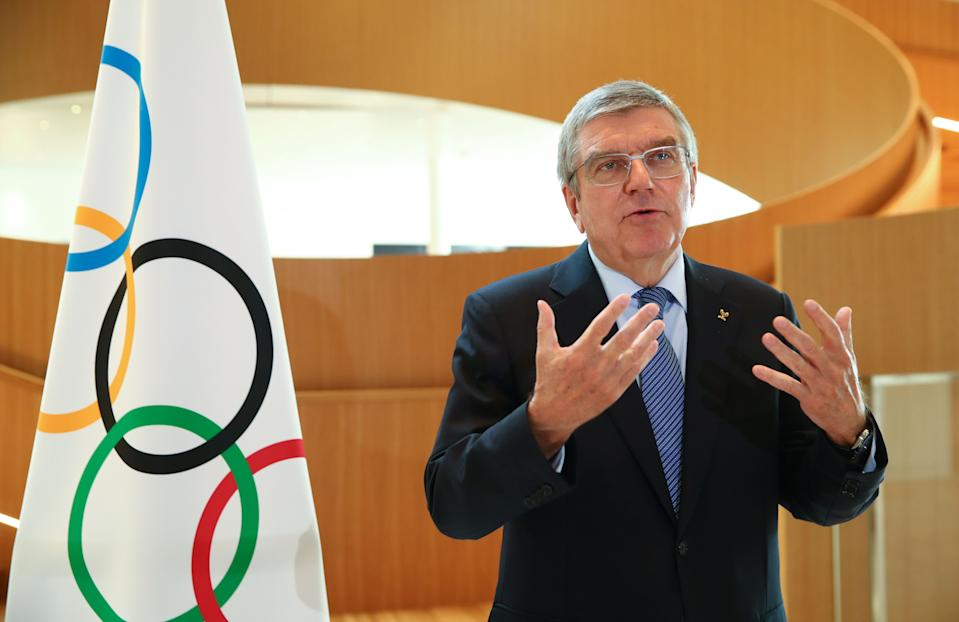 """International Olympic Committee (IOC) President Thomas Bach gestures as he speaks during an interview after the historic decision to postpone the 2020 Tokyo Olympic Games due to the coronavirus pandemic, in Lausanne, Switzerland, on March 25, 2020. - Olympic chief Bach says """"all options are on the table"""" over finding a new date to hold the postponed Tokyo Games. Tokyo 2020 became the first Olympics in peacetime to be postponed due to the coronavirus pandemic. Announcing the unprecedented decision on March 24, the International Olympic Committee gave no specific new date, saying only it would be """"beyond 2020 but not later than summer 2021"""". (Photo by Denis Balibouse / POOL / AFP) (Photo by DENIS BALIBOUSE/POOL/AFP via Getty Images)"""
