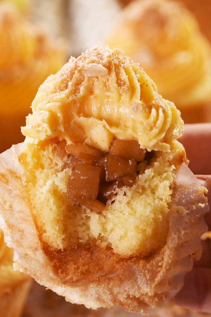 """<p>Who doesn't love apple crumble, especially when it comes out the oven golden, bubbling and delicious. So we've reimagined one of our fave desserts into these gorgeous <a href=""""http://www.delish.com/uk/cooking/recipes/g28795936/cupcake-recipe/"""" rel=""""nofollow noopener"""" target=""""_blank"""" data-ylk=""""slk:cupcakes"""" class=""""link rapid-noclick-resp"""">cupcakes</a>! </p><p>Get the <a href=""""https://www.delish.com/uk/cooking/recipes/a30220118/apple-crumble-cupcakes/"""" rel=""""nofollow noopener"""" target=""""_blank"""" data-ylk=""""slk:Apple Crumble Cupcakes"""" class=""""link rapid-noclick-resp"""">Apple Crumble Cupcakes</a> recipe.</p>"""