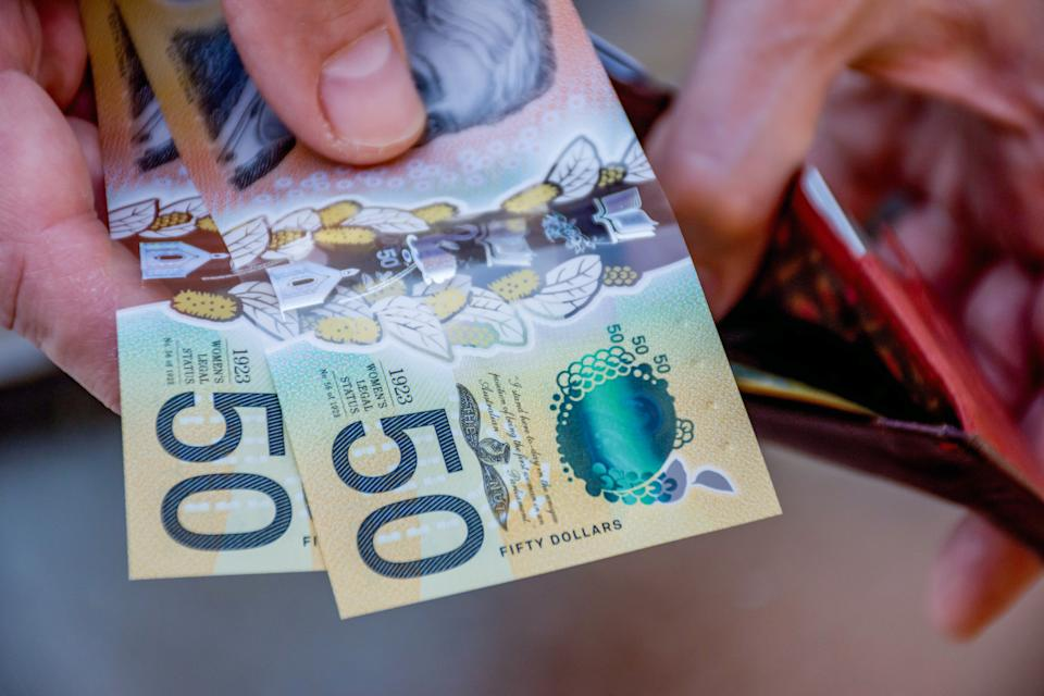 Hands holding australian dollars 50 banknotes. Finance and payment concept.