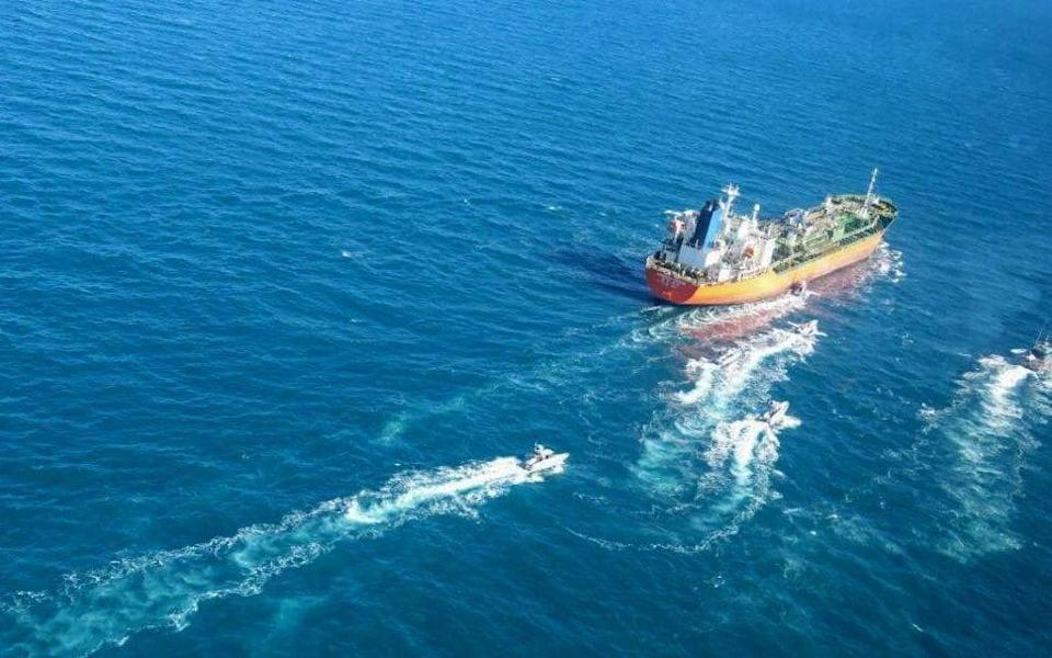 A picture obtained by AFP from the Iranian news agency Tasnim shows the South Korean-flagged tanker being escorted by Iran's Revolutionary Guards navy after being seized in the Gulf - -/AFP
