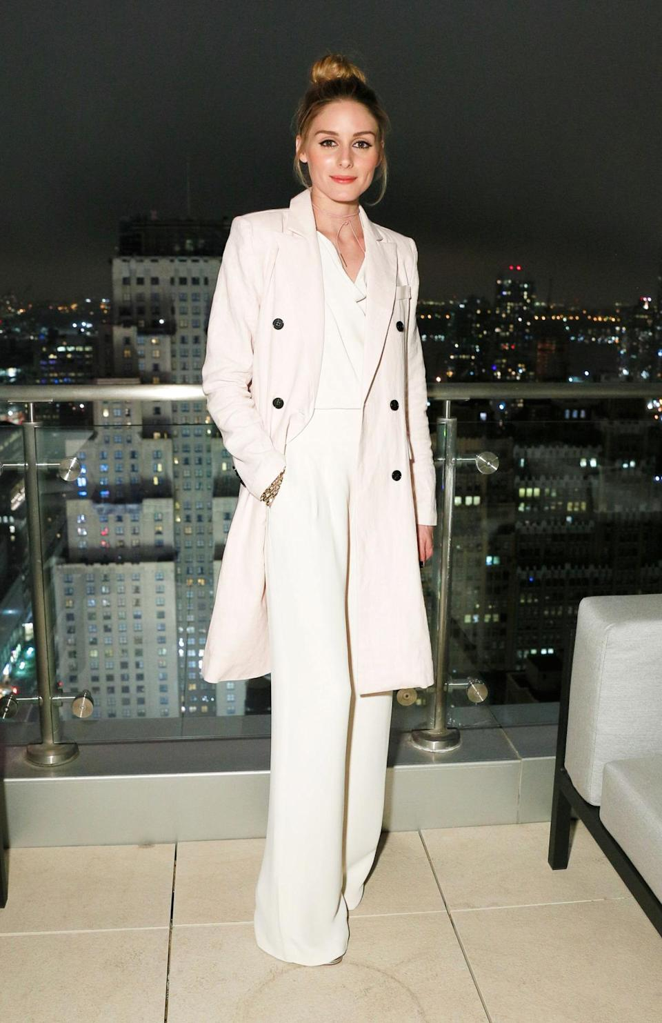 <p>You can always trust Olivia Palermo to look stunning. We love this flared white jumpsuit and matching coat. Although, our clumsy selves would never have the guts to wear this out. <i>[Photo: Rex Features]</i></p>