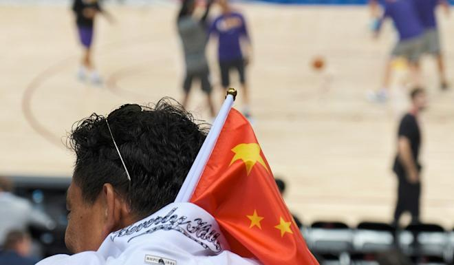 A fan sports the Chinese flag at the Los Angeles Lakers v Brooklyn Nets preseason game in Shenzhen on Saturday. Photo: Reuters