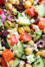 """<p>Thanks to the chickpeas, this salad will keep you full for hours. It's satisfying in a way that leafy greens never could be. Sorry not sorry, kale. </p><p>Get the <a href=""""https://www.delish.com/uk/cooking/recipes/a29843193/mediterranean-chickpea-salad-recipe/"""" rel=""""nofollow noopener"""" target=""""_blank"""" data-ylk=""""slk:Mediterranean Chickpea Salad"""" class=""""link rapid-noclick-resp"""">Mediterranean Chickpea Salad</a> recipe.</p>"""