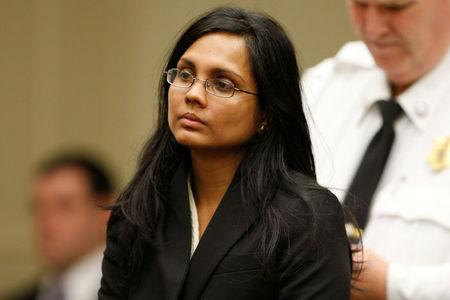 FILE PHOTO: Annie Dookhan, a former chemist at the Hinton State Laboratory Institute, listens to the judge during her arraignment at Brockton Superior Court in Brockton, Massachusetts January 30, 2013.  REUTERS/Jessica Rinaldi/File Photo