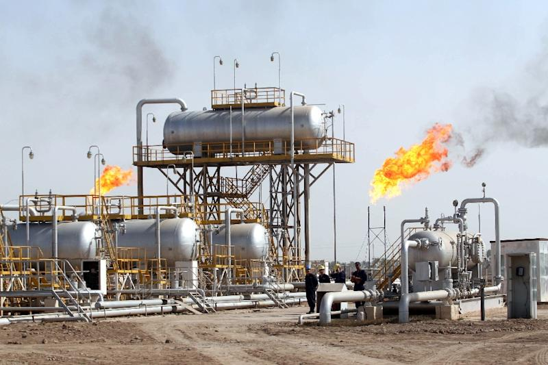 """OPEC production rose to """"a record 33.83 million barrels per day in October"""", the IEA said"""