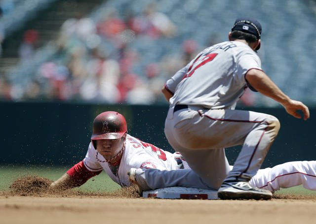 Los Angeles Angels' J.B. Shuck, left, steals second base against Minnesota Twins' Doug Bernier during the first inning of a baseball game on Wednesday, July 24, 2013, in Anaheim, Calif. (AP Photo/Jae C. Hong)