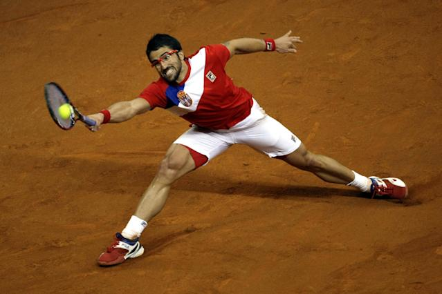 Serbia's Janko Tipsarevic returns a ball to Canada's Vasek Pospisil during their Davis Cup semifinals tennis match in Belgrade, Serbia, Sunday, Sept. 15, 2013. (AP Photo/Marko Drobnjakovic)