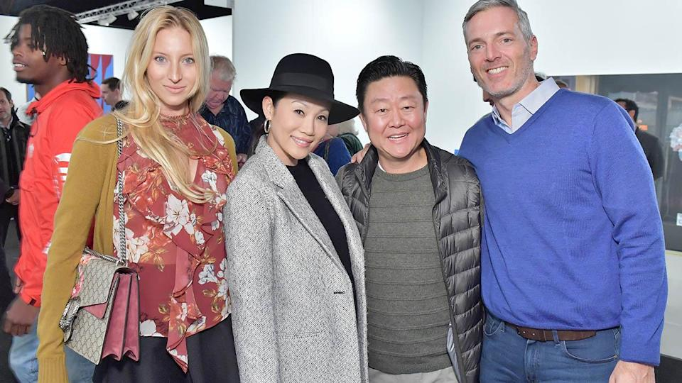 Madison Kaplan (far left) and Randall Kaplan (far right). (Photo by Stefanie Keenan/Getty Images for Art Los Angeles Contemporary)
