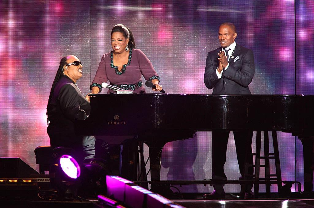 """Musical legend Stevie Wonder sat down at the piano to belt out a song he wrote especially for Ms. Winfrey. Wonder if Jamie Foxx chimed in... Barry Brecheisen/<a href=""""http://www.wireimage.com"""" target=""""new"""">WireImage.com</a> - May 17, 2011"""