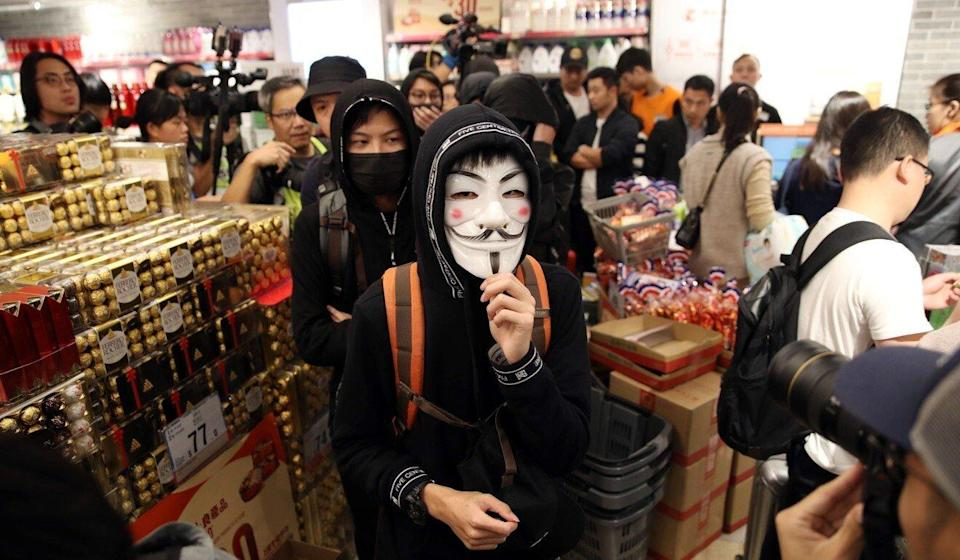 Masked protesters assemble at Landmark North shopping centre in Sheung Shui in December 2019 to show their discontent with parallel traders and shoppers from mainland China. Photo: Winson Wong