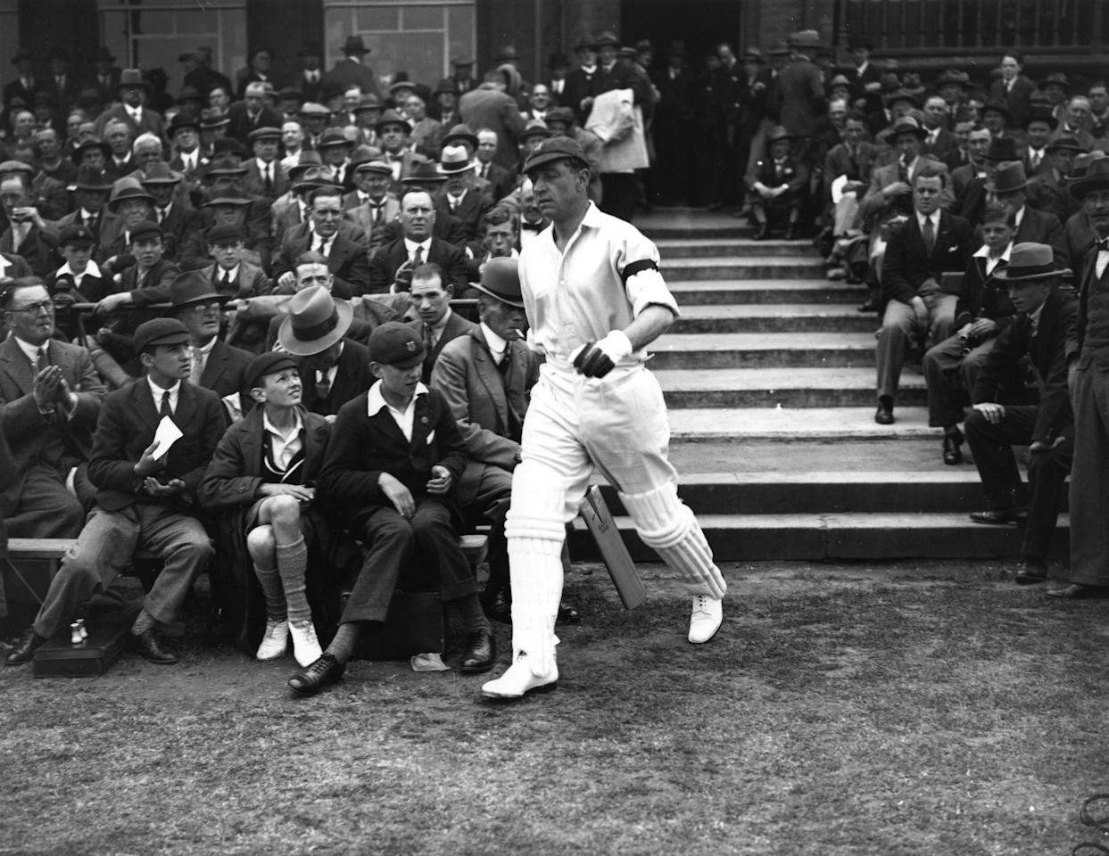 JUNE 1930:  WALLY HAMMOND OF THE MCC GOES OUT TO BAT AGAINST AUSTRALIA IN THE FIRST TEST MATCH AT NOTTINGHAM. (Photo by Central Press/Hulton Archive/Getty Images)