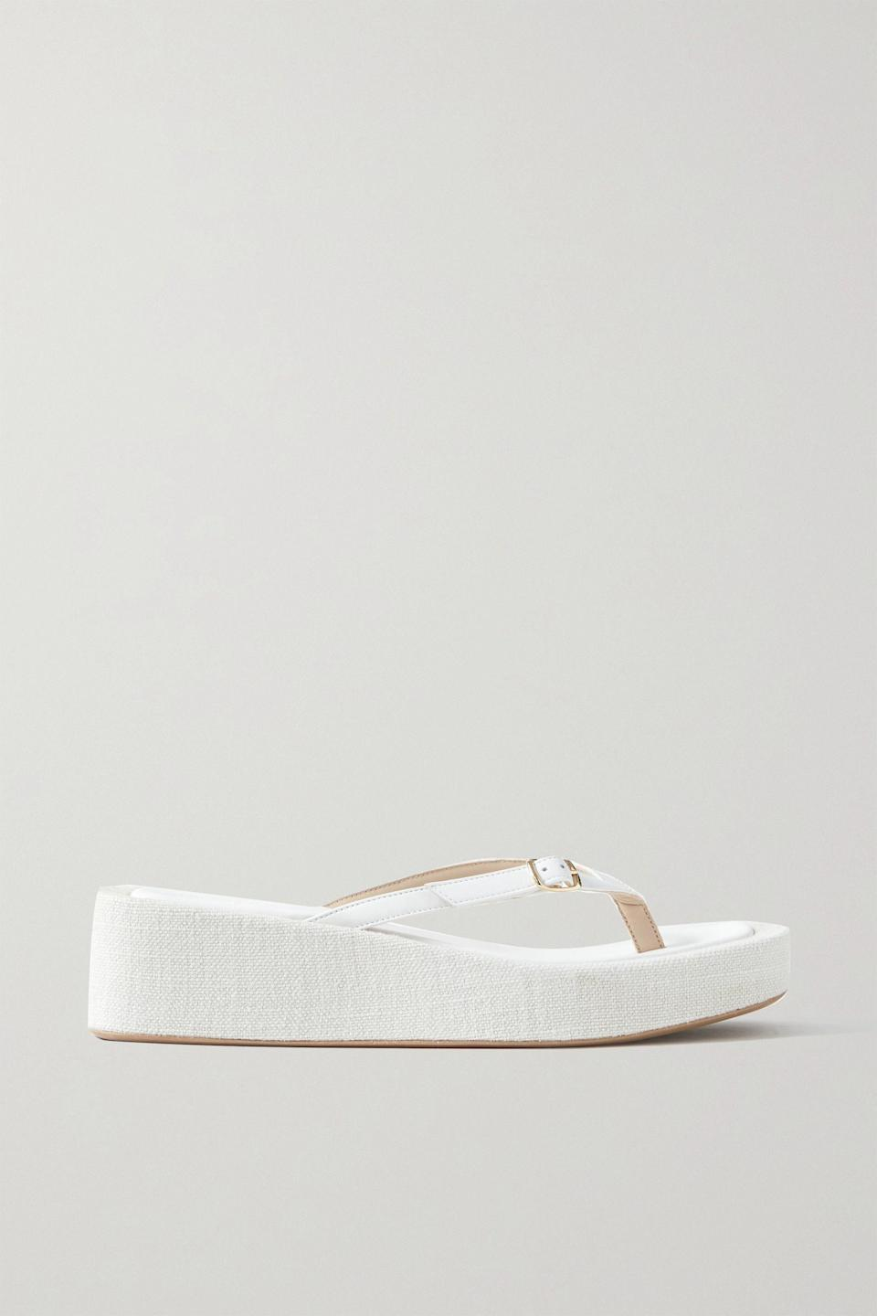 """<p><strong>Jacquemus</strong></p><p>net-a-porter.com</p><p><strong>$505.00</strong></p><p><a href=""""https://go.redirectingat.com?id=74968X1596630&url=https%3A%2F%2Fwww.net-a-porter.com%2Fen-us%2Fshop%2Fproduct%2Fjacquemus%2Fles-tatanes-lin-leather-platform-flip-flops%2F1304269&sref=https%3A%2F%2Fwww.townandcountrymag.com%2Fstyle%2Ffashion-trends%2Fg36167428%2Fstylish-platform-flip-flops%2F"""" rel=""""nofollow noopener"""" target=""""_blank"""" data-ylk=""""slk:Shop Now"""" class=""""link rapid-noclick-resp"""">Shop Now</a></p><p>These versatile linen platforms pair flawlessly with anything from mini dresses to tailored trousers—just don't forget your basket bag!</p>"""