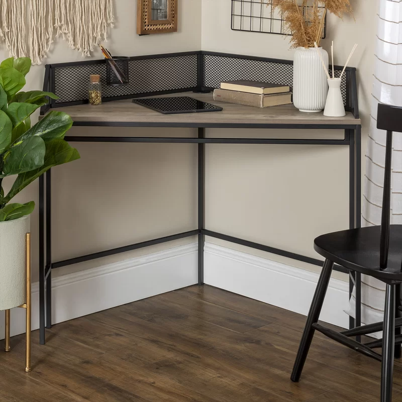 "<h3><a href=""https://www.wayfair.com/furniture/pdp/williston-forge-bowie-corner-desk-w001805005.html"" rel=""nofollow noopener"" target=""_blank"" data-ylk=""slk:Williston Forge Bowie Corner Desk"" class=""link rapid-noclick-resp"">Williston Forge Bowie Corner Desk</a></h3><br><strong>When you'd like to work somewhere that isn't your kitchen table:</strong> This compact desk is designed to tuck into a corner — transforming an otherwise neglected area inside your small-space into that designated WFH office you've been craving. <br><br><strong>Williston Forge</strong> Bowie Corner Desk, $, available at <a href=""https://go.skimresources.com/?id=30283X879131&url=https%3A%2F%2Fwww.wayfair.com%2Ffurniture%2Fpdp%2Fwilliston-forge-bowie-corner-desk-w001805005.html"" rel=""nofollow noopener"" target=""_blank"" data-ylk=""slk:Wayfair"" class=""link rapid-noclick-resp"">Wayfair</a>"