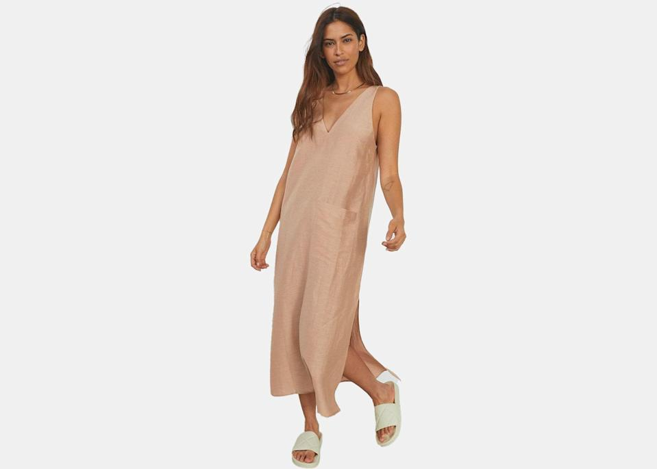 """Made of 100 percent European Flax fiber linen silk, this is the kind of dress you throw on when it's just too hot to wear anything else. But, it's also nice enough to wear out to dinner, and conveniently takes up next to no room in a suitcase. Sealing the deal? It's machine washable. $228, Lunya. <a href=""""https://www.lunya.co/products/linen-silk-double-v-midi-dress?variant=39354982072363"""" rel=""""nofollow noopener"""" target=""""_blank"""" data-ylk=""""slk:Get it now!"""" class=""""link rapid-noclick-resp"""">Get it now!</a>"""