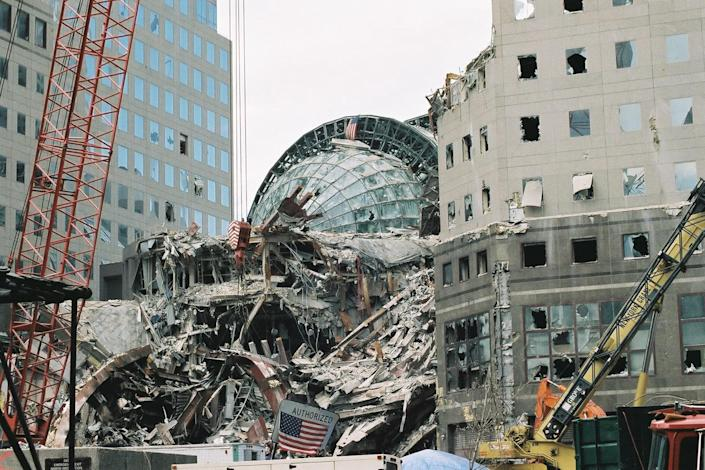 <p>Broken windows in the vaulted roof of the Winter Garden Atrium, left, and the smashed facade of the World Financial Center following the collapse of the World Trade Center, Sept. 27, 2001. (Photo: Bri Rodriguez/FEMA) </p>