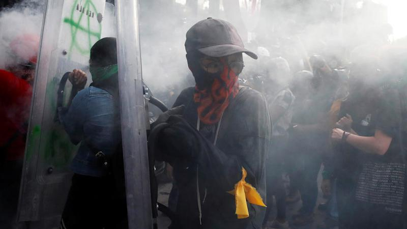 Feminist protesters battle with police in Mexico City