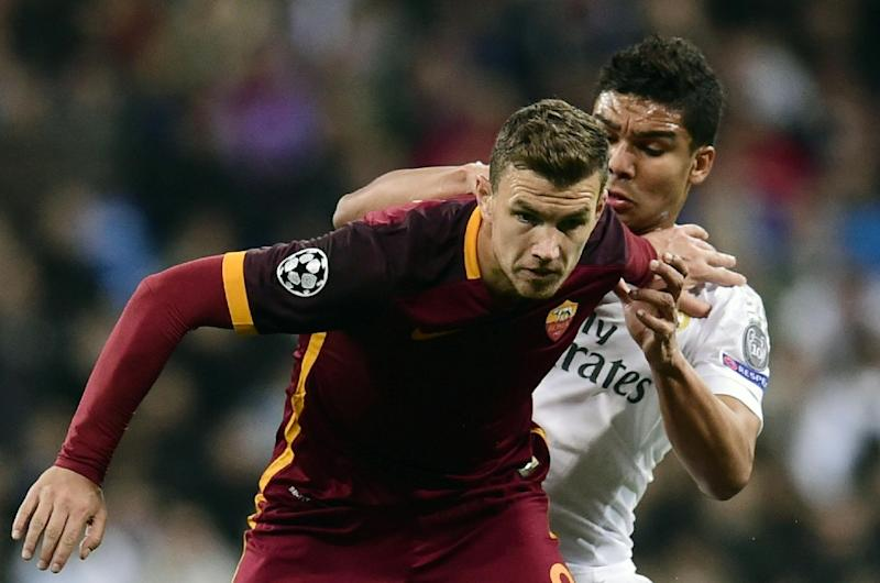 Roma's forward Edin Dzeko (front) was one of several players slated for a poor performance in the Champions League defeat to Real Madrid, on March 8, 2016