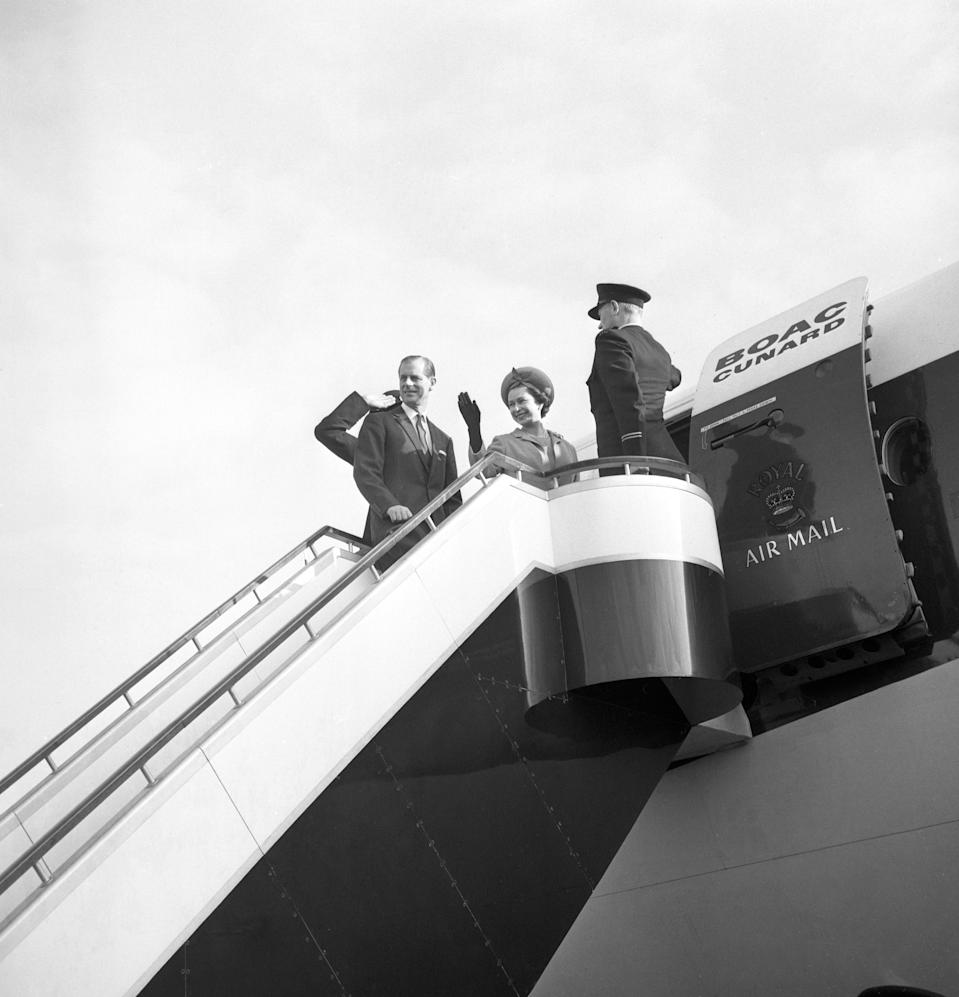 Queen Elizabeth II and the Duke of Edinburgh on the top of the steps as they board a BOAC Super VC 10 liner at London Airport to fly to Barbados at the start of a Caribbean tour. The journey had been delayed for 25 minutes while security men searched the aircraft for a bomb following an anonymous telephone call.