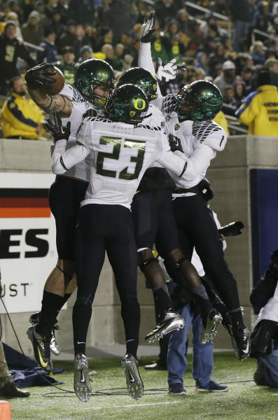 Oregon 's Colt Lyerla, at left with ball, celebrates his 14-yard touchdown reception with teammates during the second half of an NCAA college football game against California in Berkeley, Calif., Saturday, Nov. 10, 2012. (AP Photo/Marcio Jose Sanchez)