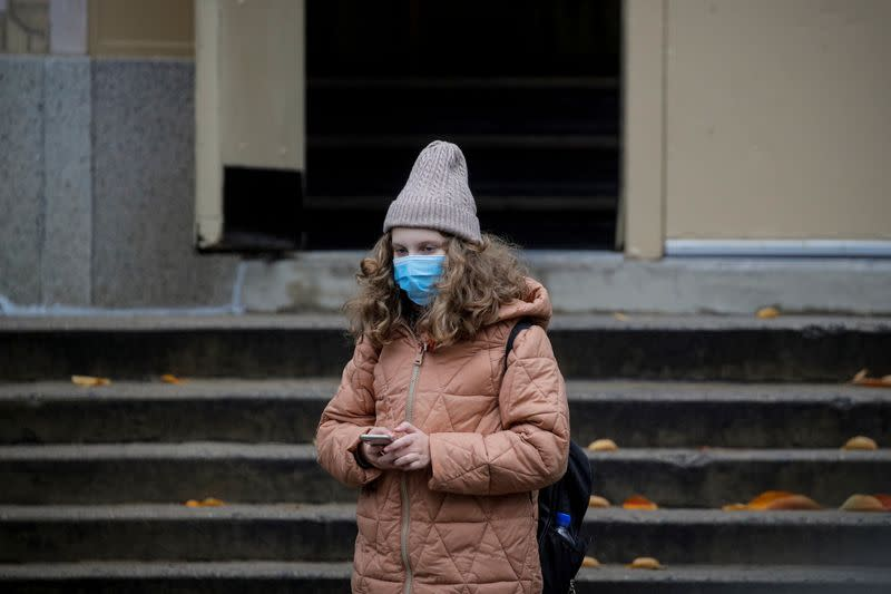 A student exits a school as the spread of coronavirus disease (COVID-19) continues, in Brooklyn, New York