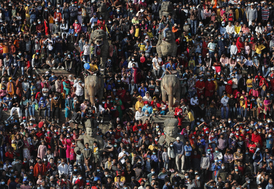 Nepalese devotees participate in Biska Jatra Festival in Bhaktapur, Nepal, Saturday, April 10, 2021. During this festival, also regarded as Nepalese New Year, images of Hindu god Bhairava and his female counterpart Bhadrakali are enshrined in two large chariots and pulled to an open square after which rituals and festivities are performed. (AP Photo/Niranjan Shrestha)