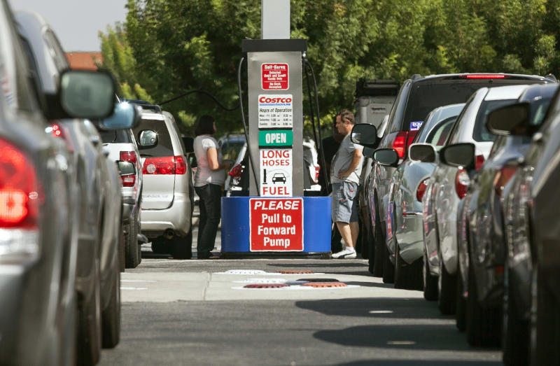 Costco members fill up with discounted gasoline at a Costco gas station in Van Nuys, Calif., Friday, Oct. 5, 2012. Californians woke up to a shock Friday as overnight gasoline prices jumped by as much as 20 cents a gallon in some areas, ending a week of soaring costs that saw some stations close and others charge record prices. (AP Photo/Damian Dovarganes)
