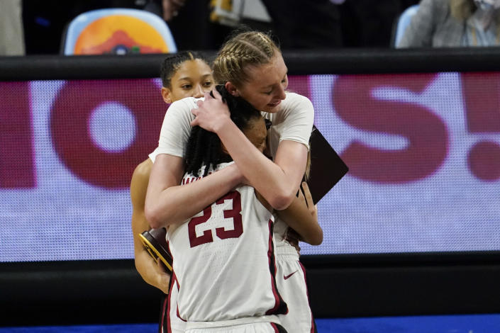 Stanford guard Kiana Williams (23) gets a hug from teammate forward Cameron Brink at the end of the championship game against Arizona in the women's Final Four NCAA college basketball tournament, Sunday, April 4, 2021, at the Alamodome in San Antonio. Stanford won 54-53. (AP Photo/Eric Gay)
