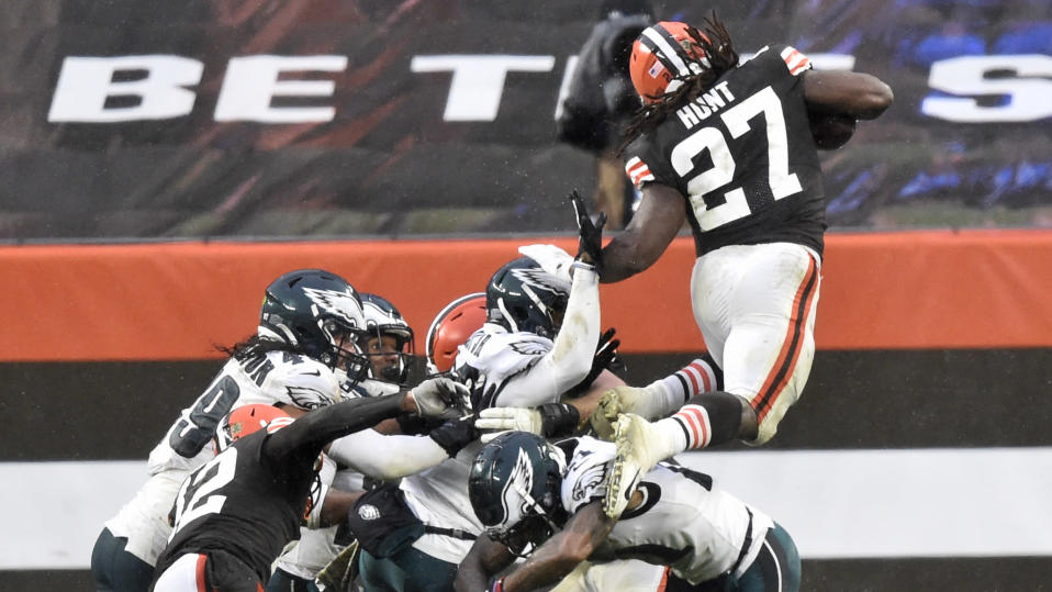 Cleveland Browns running back Kareem Hunt (27) rushes for a five-yard touchdown during the second half of an NFL football game against the Philadelphia Eagles, Sunday, Nov. 22, 2020, in Cleveland. The Browns won 22-17. (AP Photo/David Richard)