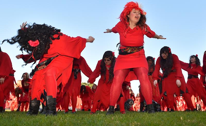 Kate Bush fans rehearse a dance before performing during a celebration to mark 'The Most Wuthering Heights Day Ever', in Melbourne, on July 16, 2016 (AFP Photo/Paul Crock)