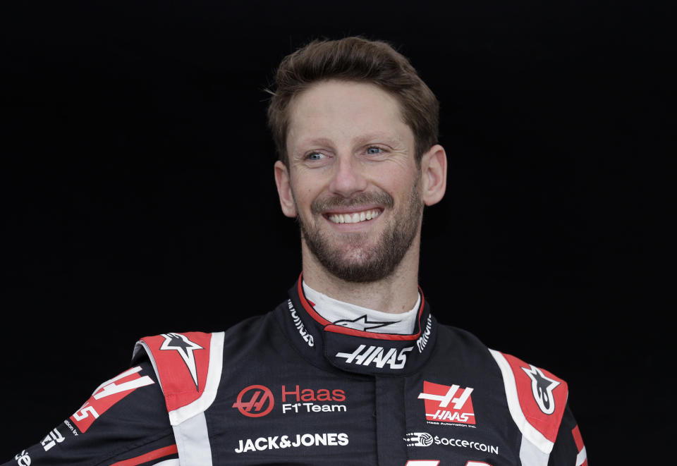 FILE - Haas driver Romain Grosjean, of France, poses for a photo at the Australian Formula One Grand Prix in Melbourne, Australia, in this Thursday, March 12, 2020, file photo. The IndyCar season begins with three new drivers for the season-opener at Barber Motorsports Park. Seven-time NASCAR champion Jimmie Johnson will be a 45-year-old rookie in a class that includes Romain Grosjean from Formula One and V8 Supercars champion Scott McLaughlin. (AP Photo/Rick Rycroft, File)