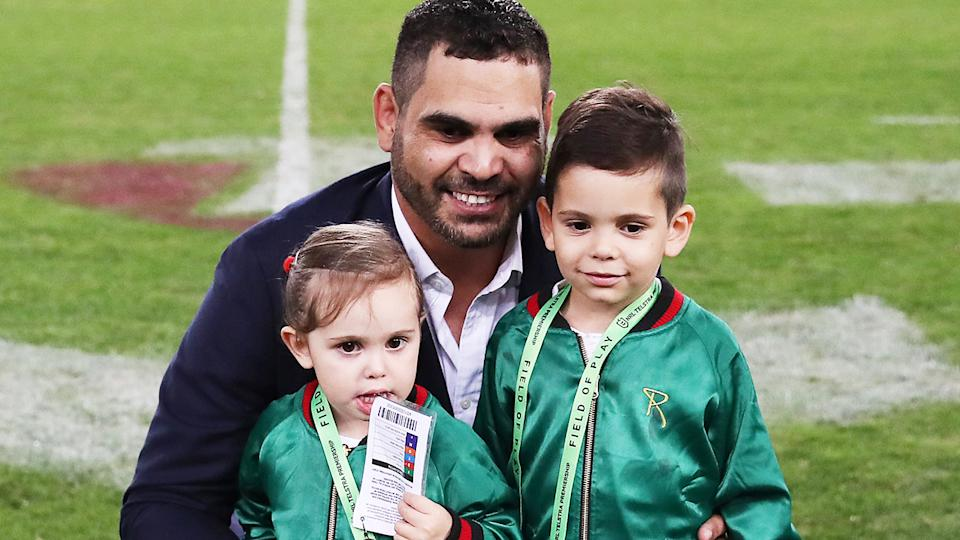 Greg Inglis, pictured here with son Nate and daughter Quinnsy after announcing his retirement in 2019.