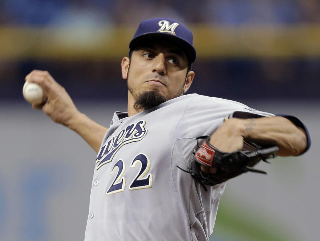 Milwaukee Brewers starting pitcher Matt Garza delivers to the Tampa Bay Rays during the first inning of a baseball game Tuesday, July 29, 2014, in St. Petersburg, Fla. (AP Photo/Chris O'Meara)