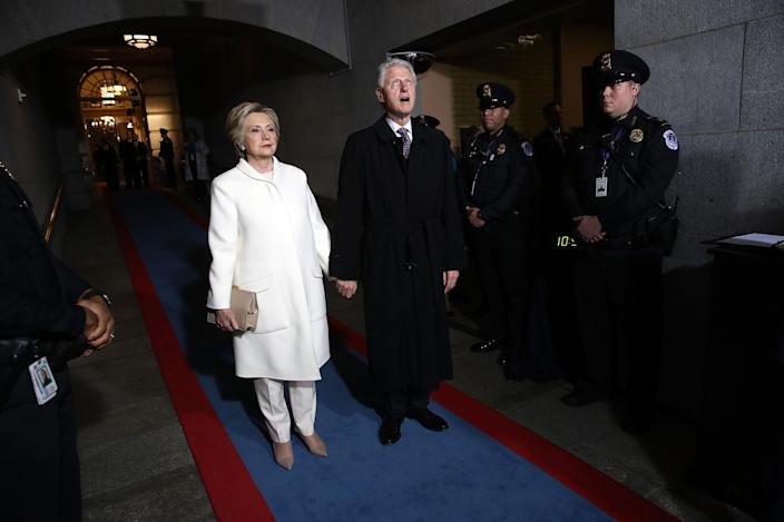 <p>JAN. 20, 2017 – Former Democratic presidential nominee Hillary Clinton (L) and former President Bill Clinton arrive on the West Front of the U.S. Capitol in Washington, DC. In today's inauguration ceremony Donald J. Trump becomes the 45th president of the United States. (Photo: Win McNamee/Getty Images) </p>