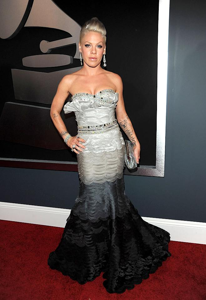 "Pink  Grade: A   Before the ""Sober"" songstress wowed the crowd with a high-flying performance, she strutted her stuff in a floor-length ombre dress by Tony Ward Haute Couture and nearly 3 million dollars worth of Neil Lane jewels. Kevin Mazur/<a href=""http://www.wireimage.com"" target=""new"">WireImage.com</a> - January 31, 2010"