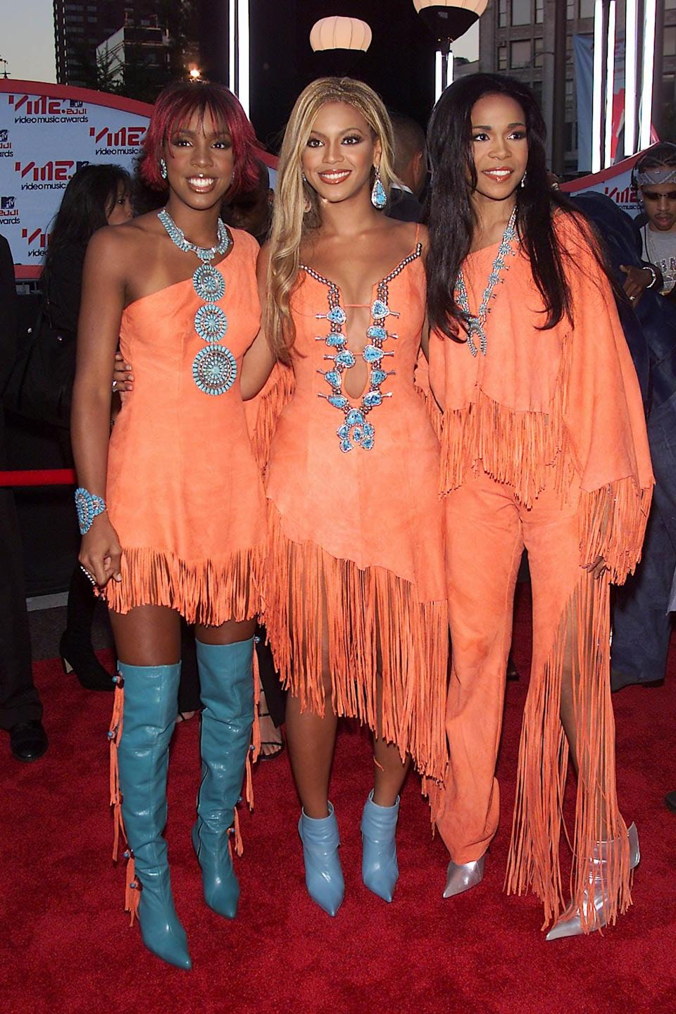 <p>Rocking orange and turqouise fringed outfits at the 2001 MTV Video Music Awards.</p>