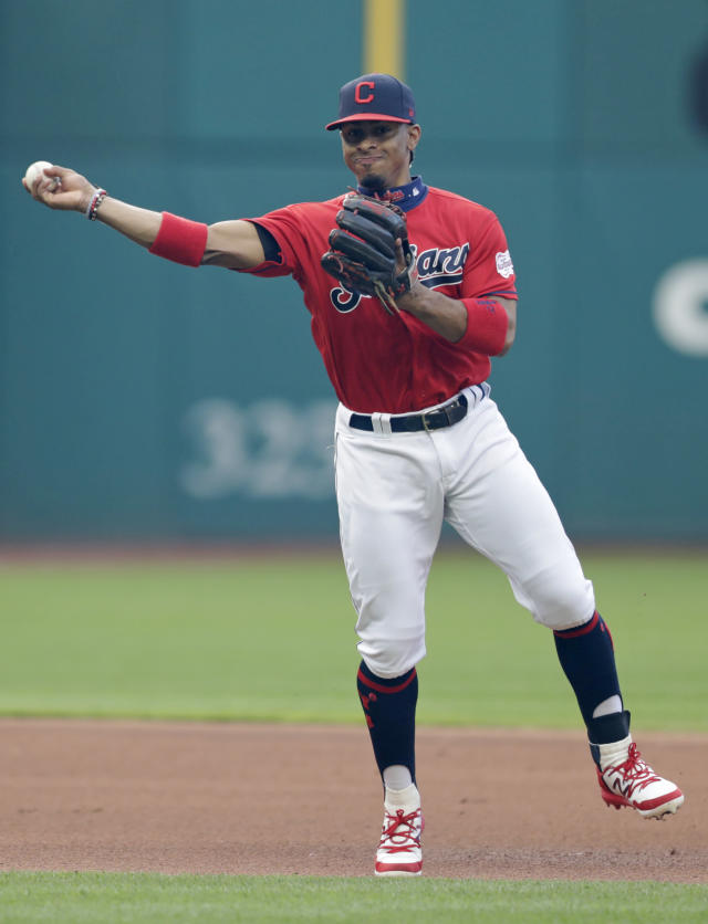 Cleveland Indians' Francisco Lindor throws out Miami Marlins' Martin Prado at first base in the fourth inning of a baseball game, Tuesday, April 23, 2019, in Cleveland. (AP Photo/Tony Dejak)
