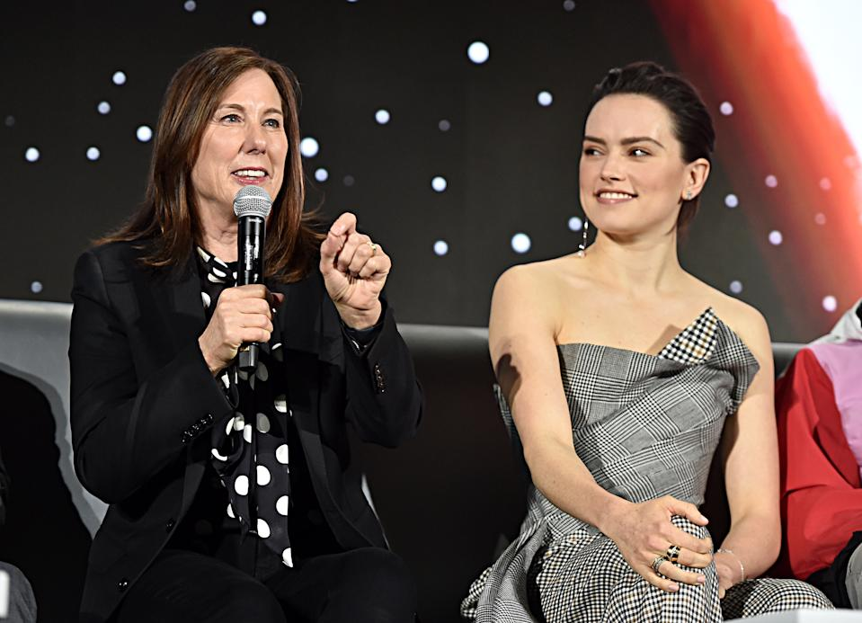"""PASADENA, CALIFORNIA - DECEMBER 04: Producer and President of Lucasfilm Kathleen Kennedy and Daisy Ridley participate in the global press conference for """"Star Wars:  The Rise of Skywalker"""" at the Pasadena Convention Center on December 04, 2019 in Pasadena, California. (Photo by Alberto E. Rodriguez/Getty Images for Disney)"""