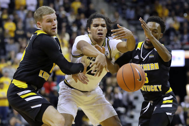 Missouri's Dru Smith, center, loses control of the ball as Northern Kentucky's Tyler Sharpe, left, and Bryson Langdon, right, defend during the second half of an NCAA college basketball game Friday, Nov. 8, 2019, in Columbia, Mo. Missouri won 71-56. (AP Photo/Jeff Roberson)