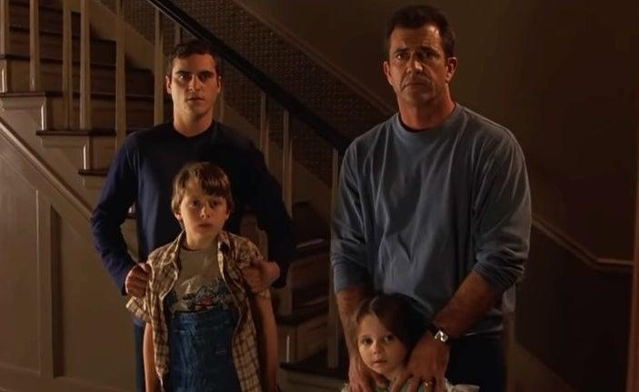 Joaquin Phoenix, Mel Gibson, and family look contemplatively at the camera