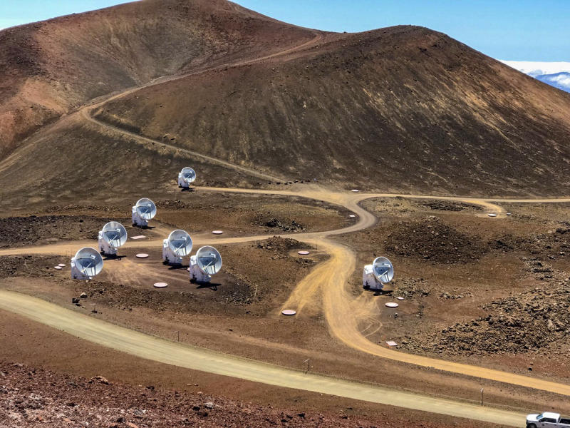 This April 4, 2019, photo, provided by Maunakea Observatories shows the Submillimeter Array, part of the Event Horizon Telescope network on the summit of Mauna Kea, Hawaii. Scientists on Wednesday, April 10, revealed the first image ever made of a black hole using these telescopes. (Maunakea Observatories via AP)