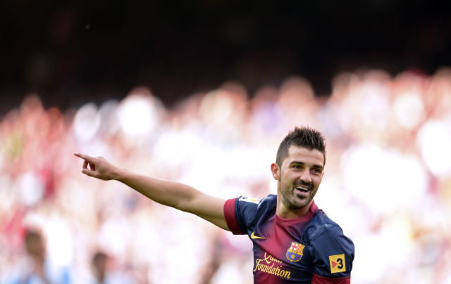 FC Barcelona's David Villa, right, reacts after scoring against Malaga during a Spanish La Liga soccer match at the Camp Nou stadium in Barcelona, Spain, Saturday, June 1, 2013. (AP Photo/Manu Fernandez)