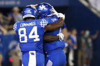 Kentucky quarterback Will Levis (7), wide receiver Izayah Cummings (84) and running back Chris Rodriguez Jr. (obscured) hug after winning an NCAA college football game against Florida in Lexington, Ky., Saturday, Oct. 2, 2021. (AP Photo/Michael Clubb)