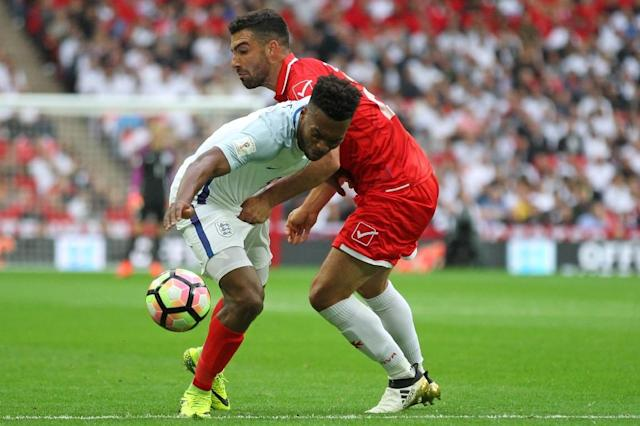 England's striker Daniel Sturridge (L) vies with Malta's defender Zach Muscat during the World Cup 2018 football qualification match between England and Malta on October 8, 2016 (AFP Photo/Ian Kington)