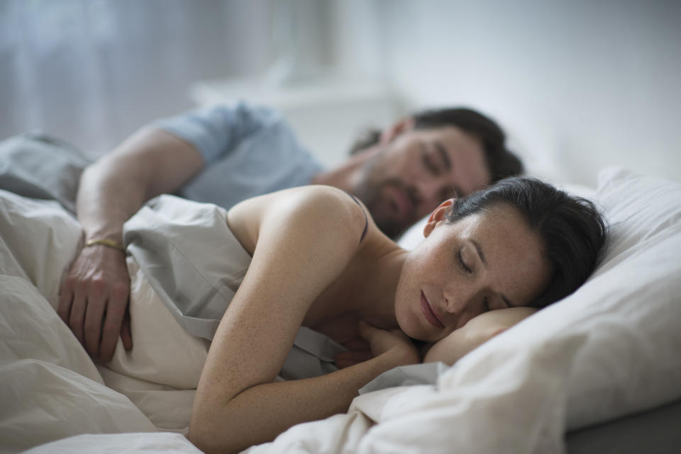 If you want a better night sleep, sleep together, researchers say. (Getty Images)