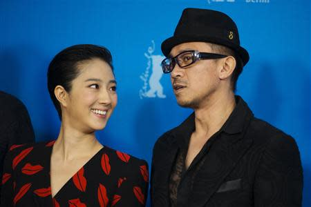 """Cast members Gwei and Wang pose during a photocall to promote the movie """"Black Coal, Thin Ice"""" at the 64th Berlinale International Film Festival in Berlin"""