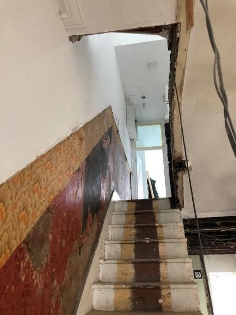 """BEFORE: """"The original loft was nastily done and much smaller than we needed,"""" says Anna. """"So we started over and turned it into a three-room space."""""""
