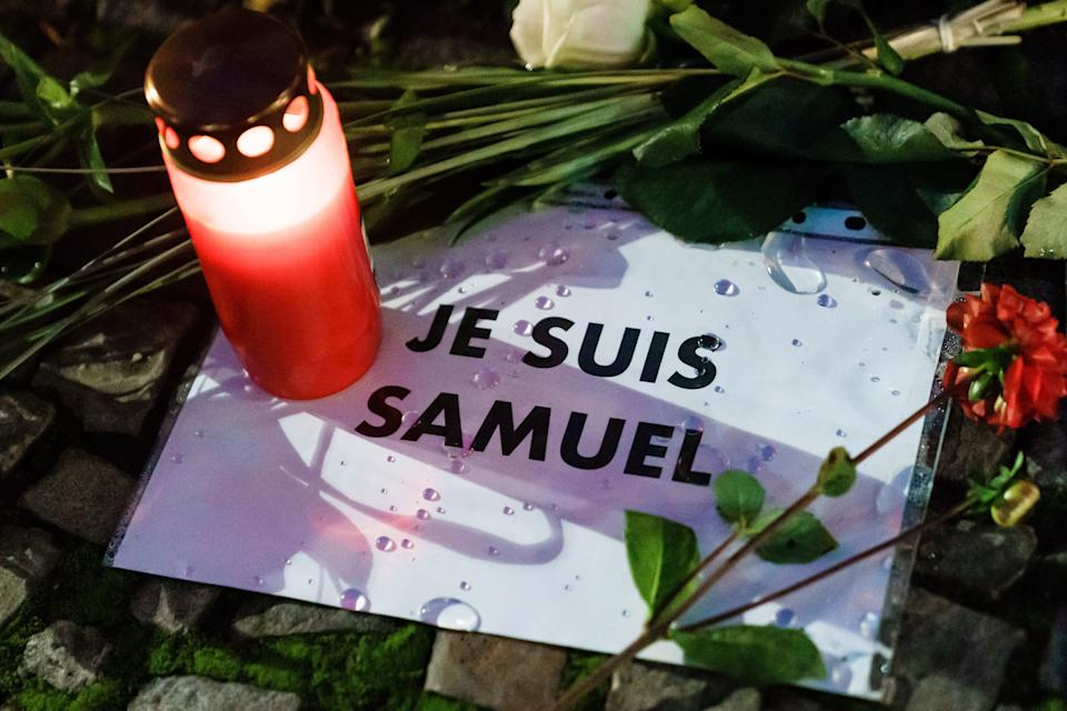 <p>A tribute to Samuel Paty is left outside the French embassy in Berlin</p>EPA
